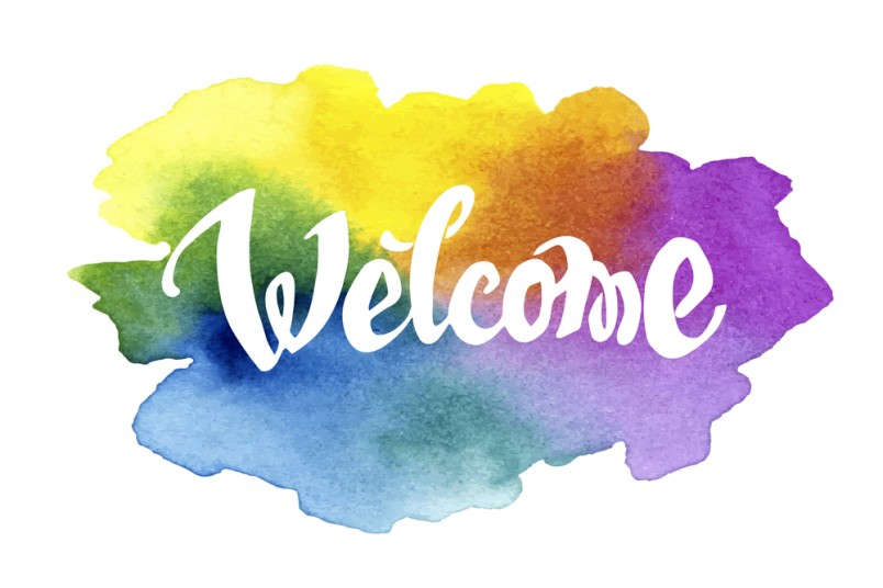 Welcome hand drawn lettering against watercolor background